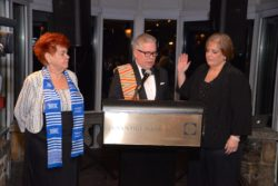 Richard Haggerty swears in HGMLS President Renee Zurlo